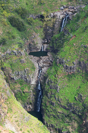"On the so-called ""Ditch hike"" to the Poomau overlook, we passed through some of the prettiest parts of Kauai we've seen anywhere.  This triple waterfall is what we looked down upon from a perch on the far side of the canyon.  Please see my blog for a complete description of the hike!"