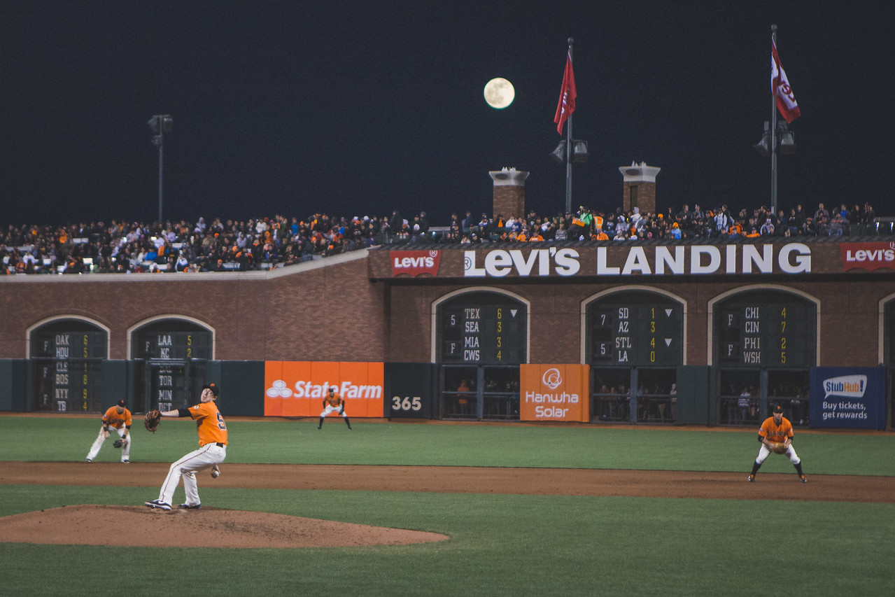 Tim Linceum pitches under a full moon at AT&T Park for the San Franciso Giants against the Colorado Rockies