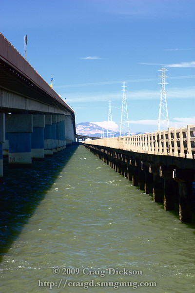 Looking out between the San Mateo Bridge and the old, unused fishing pier.