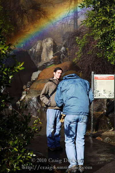 Dave Wyman photographing Lee under a rainbow at the base of the Yosemite Falls