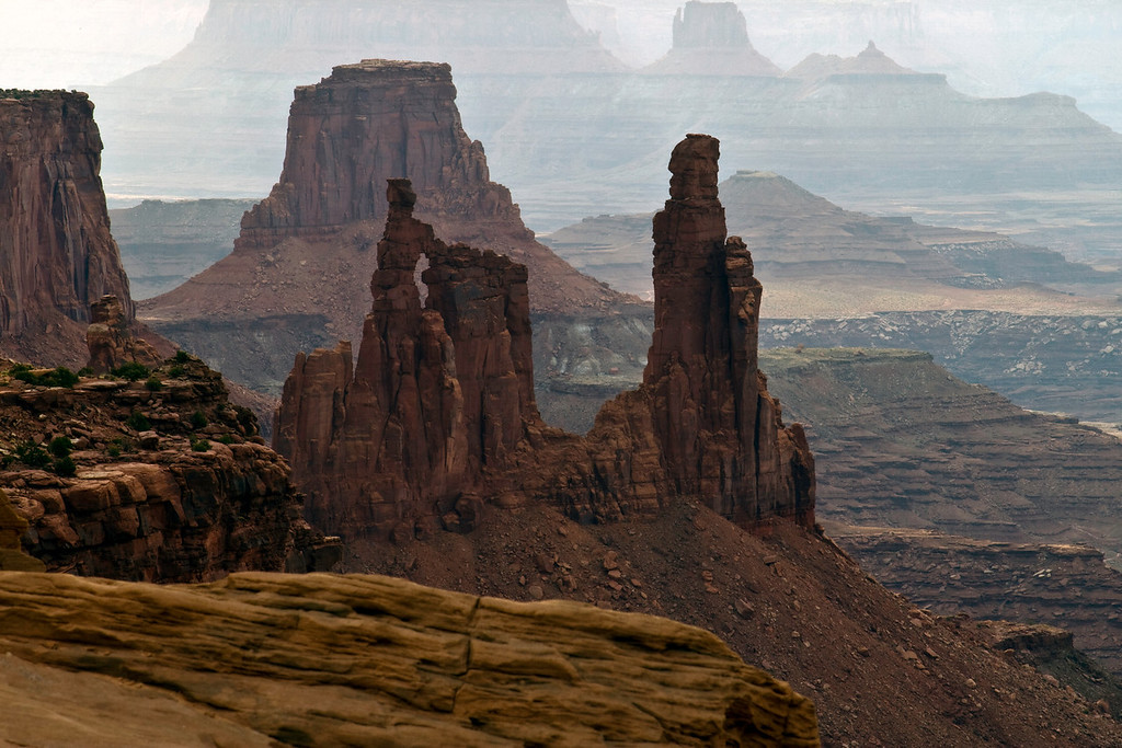 The Old Washer Woman Arch (shot through Mesa Arch.)  Canyonlands National Park, UT.
