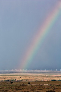 Rainbow over the wind turbine field north of Ft. Sumner, NM, June 30, 2012. Not a very good photo, but also not a common event.