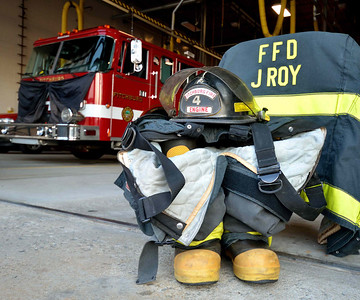 FF Jim Roy's gear sits in front of the empty Engine 4 bay.