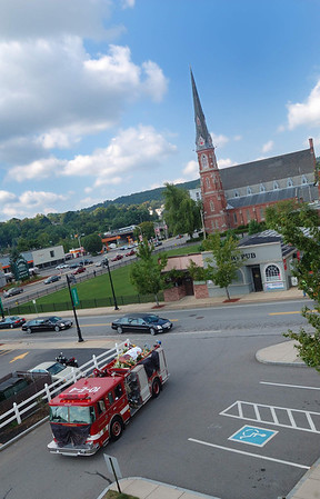 Engine 4 makes it's turn into Central Station bringing FF Jim Roy to the station one last time.