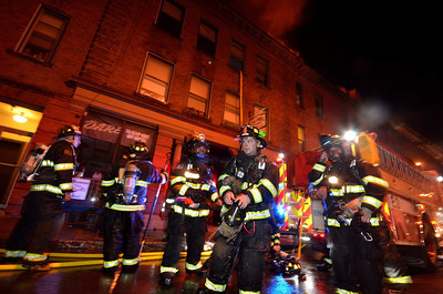 Leominster FFs grab another bottle to go back in at the 7th Alm on Columbia St downtown in November.