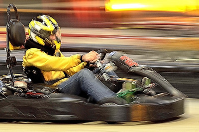 Jack doing his best Sebastian Vettel imitation. Looking fast at indoor karting in Maine.