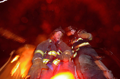 Possibly my favorite fireground photo of the year. Two of my favorite people; FF Brian Packard of the Devens FD and FF David Monty of the Westminster FD shortly after assisting in the rescue of 2 FFs from the bucket of Westminster Tower 1 after a section of wall and roof collapsed on it during the 7th Alm in Leominster in November.