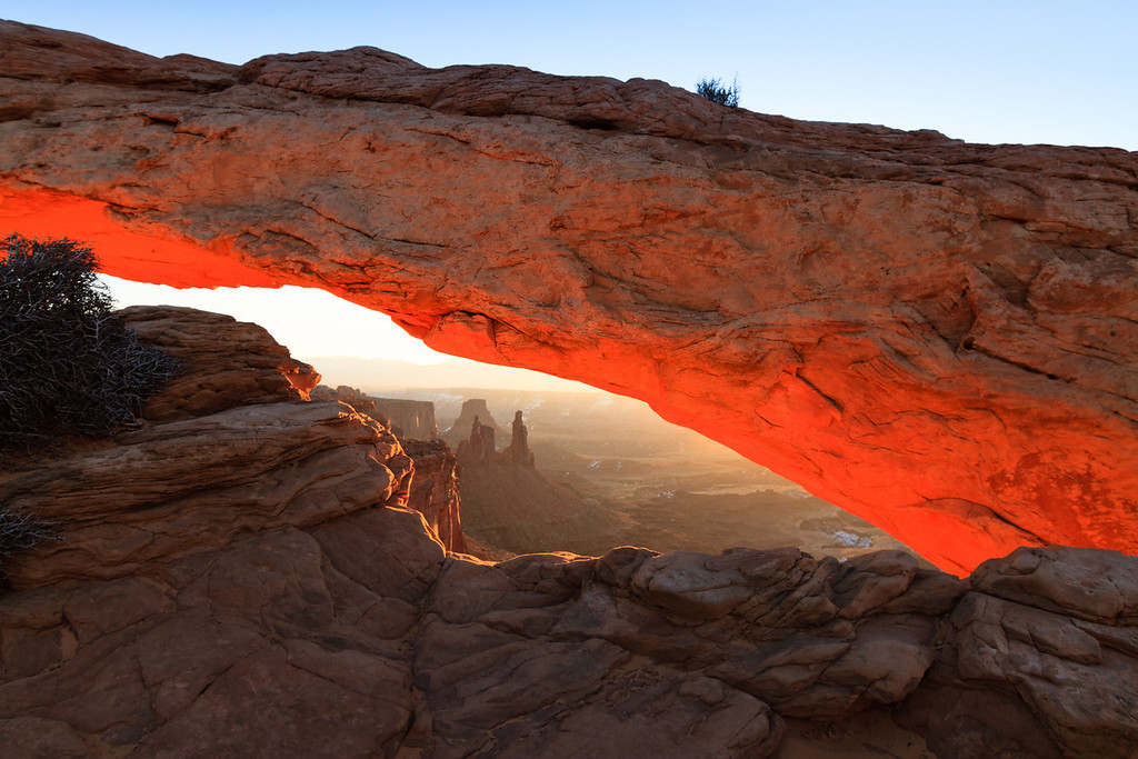 The Mesa Arch at Sunrise. Old Washer Woman Arch in the background. Canyonlands National Park near Moab, UT.
