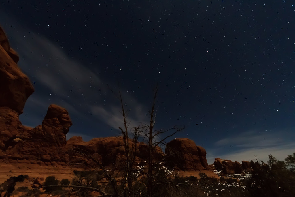 Arches National Park, Moab UT under moonlight.<br /> <br /> With a half-moon about an hour after sunset, there was enough moonlight to illuminate the foreground under a soft glow while still allowing the stars to shine through.  It was an amazing night to take photos.