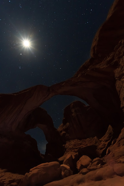 The Double Arch under moonlight. Arches National Park, Moab UT.<br /> <br /> With a half-moon about an hour after sunset, there was enough moonlight to illuminate the arch under a soft glow while still allowing the stars to shine through. It was an amazing night to take photos.