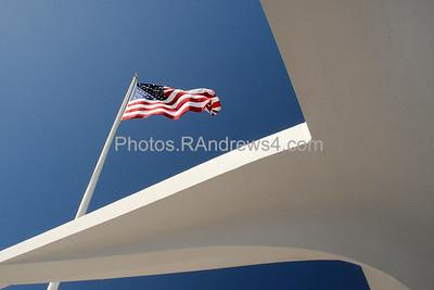 American flag flies above Arizona memorial at Pearl harbor