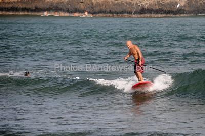 Paddle surfer in Nawiliwili Bay