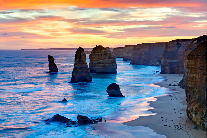 """12 Apostles at Sunset"" Great Ocean Road, Victoria, Australia. The 12 Apostles has been at the top of my bucket list ever since seeing images of this amazing place! I had a business trip to Australia this summer and managed to head down the Great Ocean road (on the other side of the road!!) to capture this. I went during mid-day to scout and came back for fantastic sunset. I just 'found' my images again and finally published this one. I hope you enjoy it and add it to your list of amazing places to go! You can see the location via Google Maps here: <a href=""http://g.co/maps/g4w9d"">http://g.co/maps/g4w9d</a>     This image looks great above the couch or in a conference room. A recent collector did this as a 24"" x 36"" HD Acrylic Crystal Flex image just glowing on the wall.  Fine Art Images for Collectors, Healthcare and Corporations. Perfect for Executive Briefing Centers."