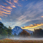 """'Half Dome in Yosemite at Sunrise"""" Half Dome looked stunning the morning I captured this. The low lying fog through Cooks Meadow with the colors in the sky. Yosemite National Park can be so amazing and different every time you visit. My favorite time is to be there in the Fall with very few people visiting. Early in the morning you can be the only person walking around. I am still hoping to pop up there in the next few weeks. Anyone else been lately?! Copyright John Harrison Photography — at Yosemite National Park.  -- You can purchase this here:  <a href=""""http://bit.ly/1d7ZB3x"""">http://bit.ly/1d7ZB3x</a>     Fine Art Images for Collectors, Healthcare and Corporations. Perfect for Executive Briefing Centers."""