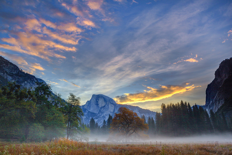 "'Half Dome in Yosemite at Sunrise"" Half Dome looked stunning the morning I captured this. The low lying fog through Cooks Meadow with the colors in the sky. Yosemite National Park can be so amazing and different every time you visit. My favorite time is to be there in the Fall with very few people visiting. Early in the morning you can be the only person walking around. I am still hoping to pop up there in the next few weeks. Anyone else been lately?! Copyright John Harrison Photography — at Yosemite National Park.  -- You can purchase this here:  <a href=""http://bit.ly/1d7ZB3x"">http://bit.ly/1d7ZB3x</a>     Fine Art Images for Collectors, Healthcare and Corporations. Perfect for Executive Briefing Centers."