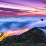 """A portion of """"Above the Fog""""  The original panorama can be seen here: <a href=""""http://bit.ly/1bmDXFx"""">http://bit.ly/1bmDXFx</a>  I love shots of San Francisco and the Golden Gate Bridge but never had gotten the perfect shot with the Golden Gate Bridge poking through the fog. I saw the weather report at 11:30pm the evening before saying """"your commute will be slow in the morning with low lying fog across the Golden Gate Bridge"""" I thought PERFECT! I'll head up in a few hours! I set out in the dark for the drive up to San Francisco to shoot from the Marin Headlands.<br /> <br /> The hike up the hill in the dark and the fog with too much camera gear (30 pounds!) gave me a great early morning workout! I arrived just as the sky was starting to have an amazing glow and the fog was swirling beneath the bridge. I decided to go for a longer exposure to capture the lights of the cars heading to the Golden Gate Bridge. On the right side of the photo you can see some cars heading along Conzelman Road. I just love the curves and swirling fog together with the bumps in the hillside. It only took me a month to process my image :-)<br /> <br /> The glow of the San Francisco lights, Car lights and Golden Gate Bridge and colors in the sky balanced with the greens of the hill and fog are what caught my eye. I went for a 1:2 panorama format for this which will look great above a fireplace, couch or in an executive boardroom printed 30"""" x 60"""" or larger!<br /> <br /> This a single shot from the Nikon D800, Nikon 28-70mm f/2.8 lens (28mm), 30 seconds, f/13 and ISO 200. This is processed in Lightroom 4 and post processing in Adobe Photoshop CS6. I did not bring my Singh-ray neutral density filters on this trip but used the awesome digital ND filters in LR4 - my favorite feature of LR4!<br /> <br /> It is always a crap shoot as it can be clear in the Southbay down in Sunnyvale where I live and how the fog is in San Francisco. Sometimes the fog is higher up and obscures everything and never cl"""