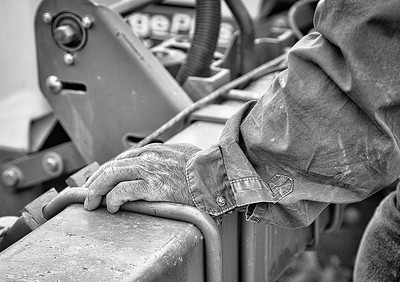 Farm worker's hand on a tractor toolbar, Hale Center TX 2018.