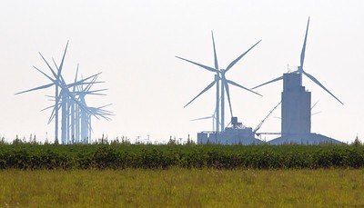 Grain elevator and wind turbines near Lockney, Texas. There was a significant amount of haze from California wildfires.