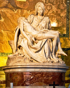 The Pieta by Michaelangelo is on the right side of the nave in Saint Peter's Basilica.  When I was very young, I saw the Pieta on loan from the Vatican at the 1964 World's Fair in New York.  In 1972, a mentally disturbed man attacked the sculpture with a hammer in St. Peter's.   Since then, it was repaired and has been kept behind bulletproof glass in Saint Peter's.  The glass makes taking photographs difficult.