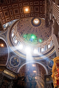 Sunlight shines through the windows below the dome of Saint Peter's Basilica.