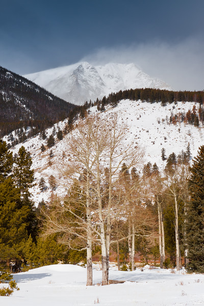 <FONT SIZE=3>Snow blowing off a peak in the Rocky Mountain National Park.</FONT>
