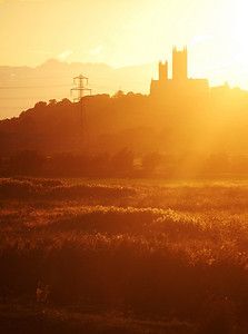 Fields of gold, as the sun sets behind Lincoln Cathedral
