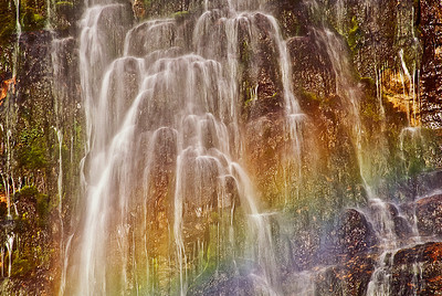 abs21:  Detail of Stewart Falls, Wasatch Mountains.  The diagonal colors are not in the rock, but are from a rainbow formed  as the early sunlight shines through the falling water mists.