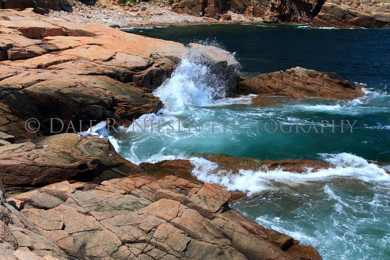 Waves gently crashing against the rocks at Acadia National Park