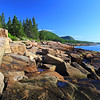 The rocky shore of Acadia National Park looking toward Sand Beach