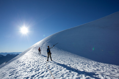 Final knife ridge of snow leading to the summit block of Mount Challenger