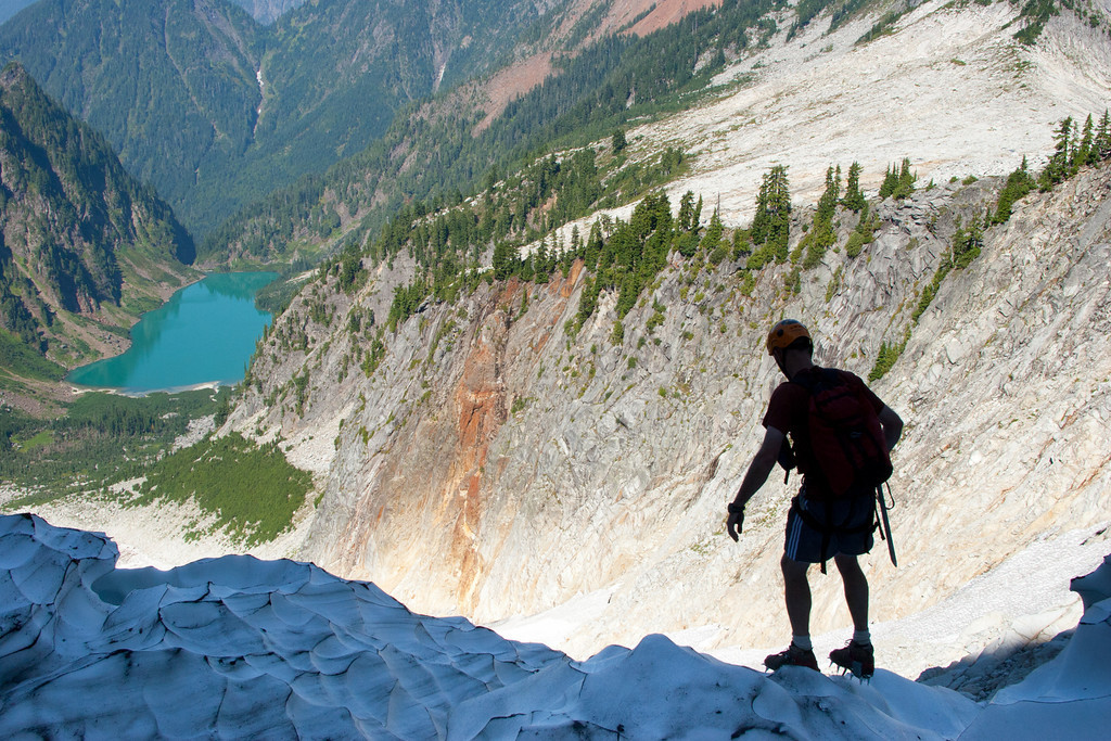 Stepping onto the glacier. Descending to the start of the rock climb up the north face of Vesper Peak.