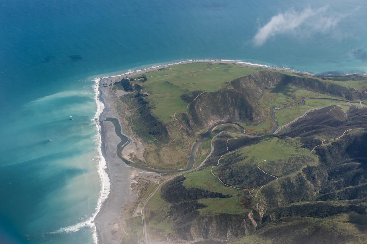 Baring Head / Ōrua-pouanui and the Wainuiomata River mouth. Air New Zealand flight Napier to Wellington.