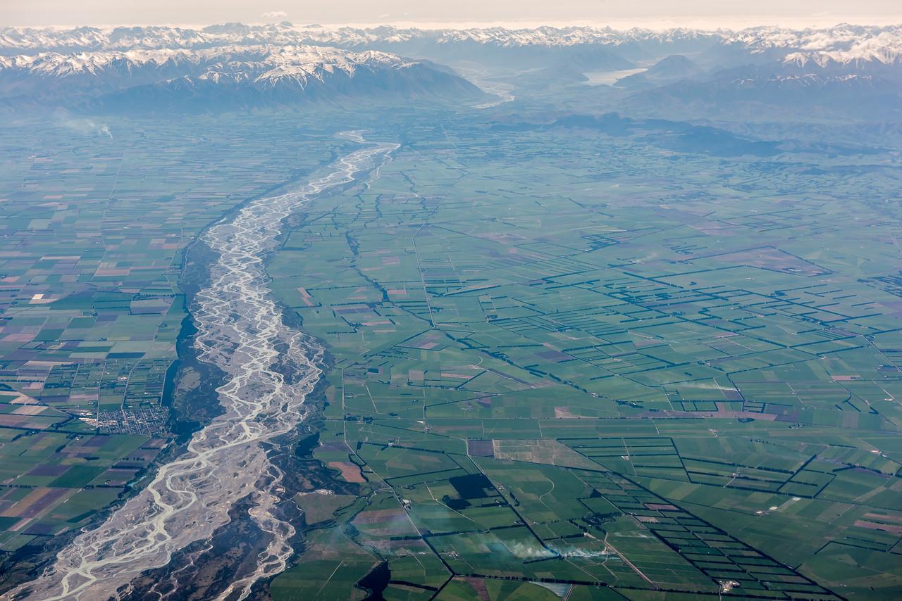 Rakaia township and river. Lake Coleridge is in the far distance. Air New Zealand flight Wellington to Dunedin.