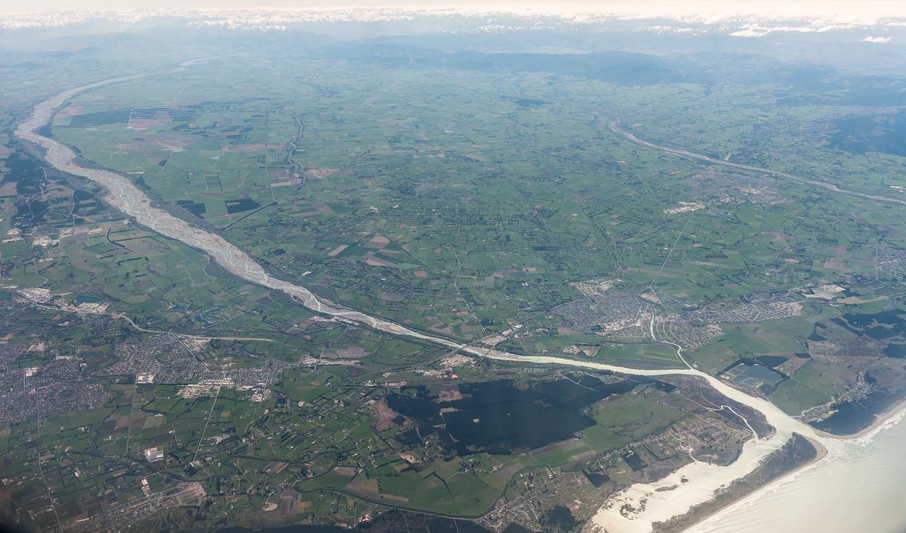 Waimakariri River mouth and Kaiapoi. Air New Zealand flight Wellington to Dunedin.