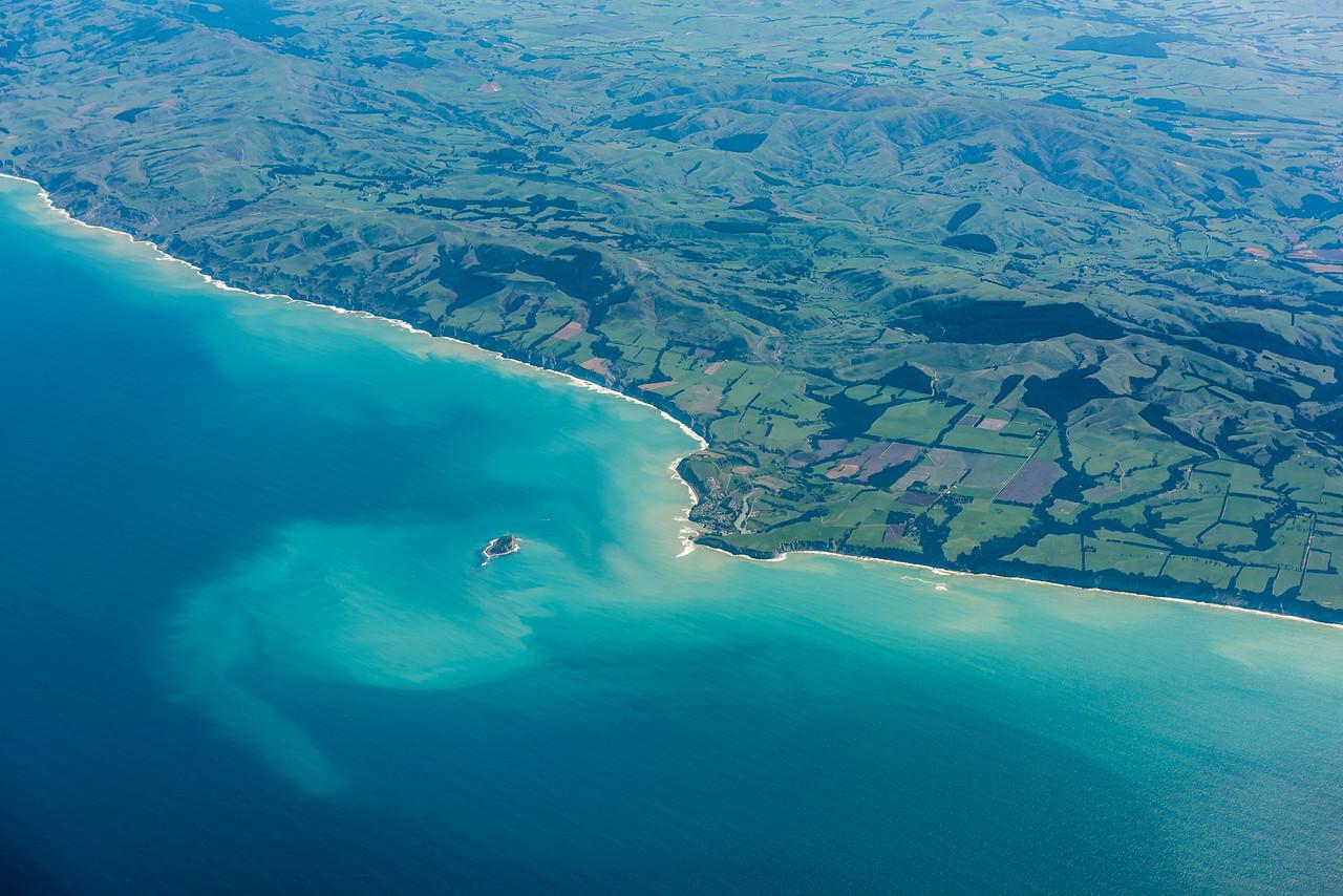 Motunau Beach and Motunau Island. Air New Zealand flight Wellington to Dunedin.