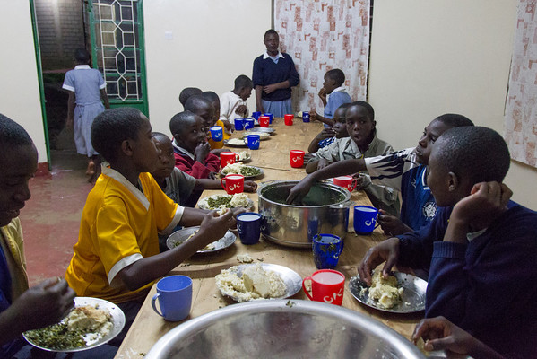 Dinner time at Kipkaren Children's Home. This evening dinner is Ugali, (African cornmeal mush) cooked Kale and milk.