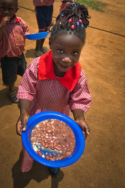 "It is much like Christmas at the school/orphanage with a donar stepping up to help feed our 2,200 kids with beans and corn flower (""Posho"").  Previously they had been eating one meal every 2-3 days."