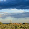 Sunrise on Karoo Windmill, with approaching storm, Kambro farm
