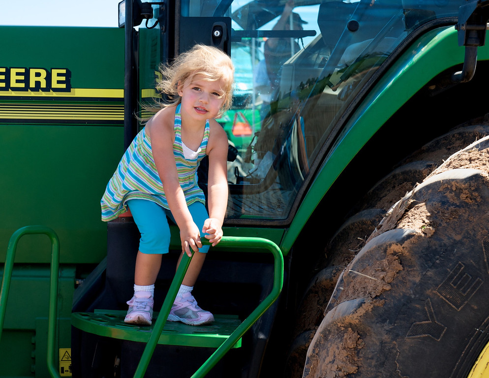 Girl on tractor. There is an altered version of this image in the Velvet Elvises gallery.