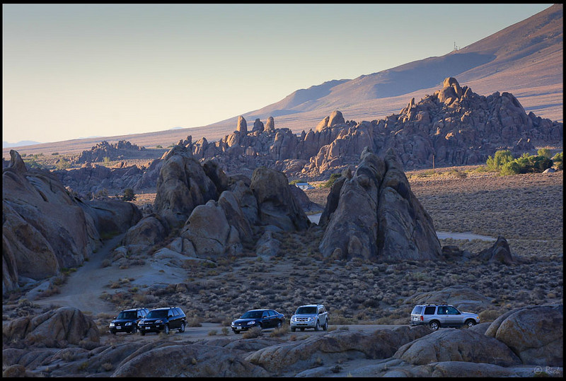 SUVs gathering at parking lot, early morning  Alabama Hills, CA