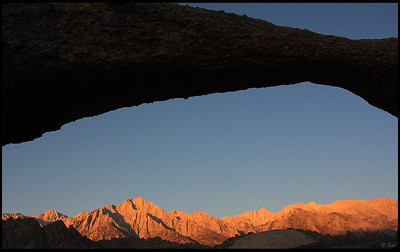 Mt. Whitney seen through Lathe Arch, sunrise  Alabama Hills, CA