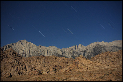 Mount Irvine (left) and Mount Whitney (right) at night with star trails  Alabama Hills, CA
