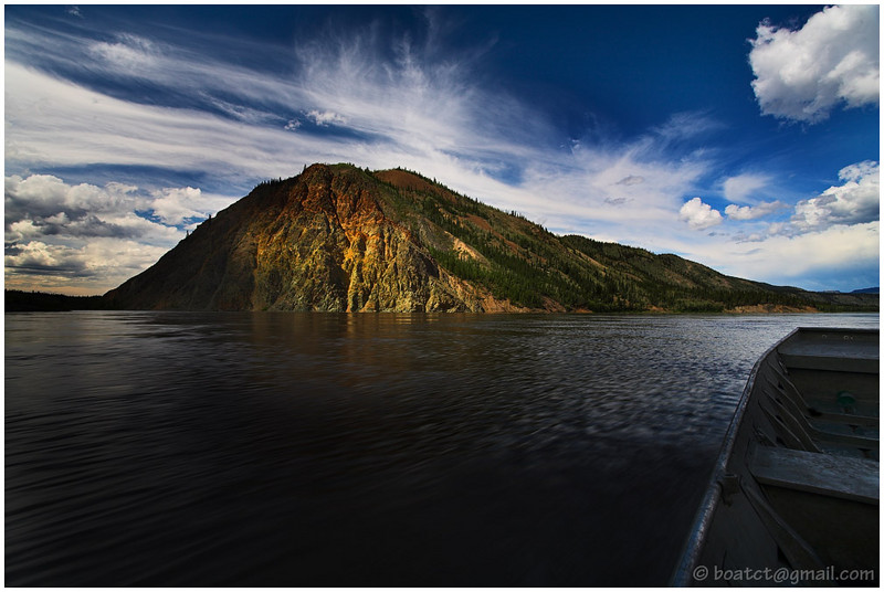 A break in the clouds allowed the sun to punch up Eagle Bluff quite nicely. We were blasting down the Yukon at 30mph so this is the best I could do.