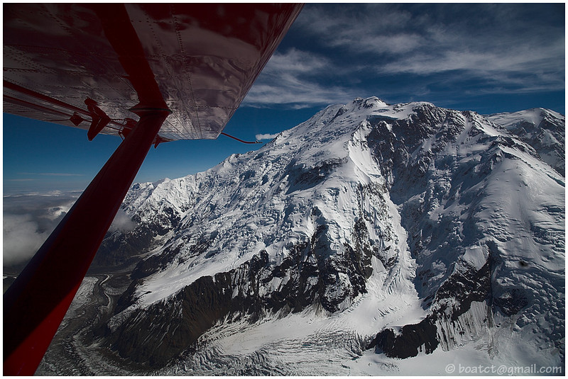 Cruising at 12k feet within spitting distance of these huge mountains is both enlivening and humbling. It forces one to realize that our aircraft and its passengers are a mere fly to this massive mountain range!
