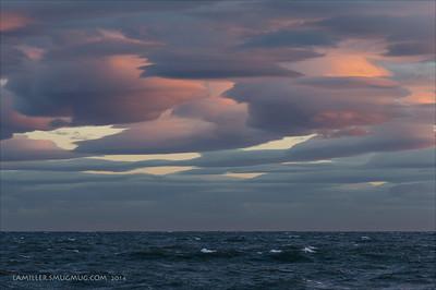 Nearing midnight, gale force winds sculpt clouds over Kachemak Bay, Alaska.