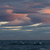 Nearing midnight, gale force winds sculpt clouds over Kachemak Bay, Alaska.