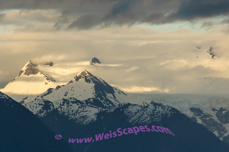 Sunset clouds over the mountain tops, Inside Passage of Alaska.