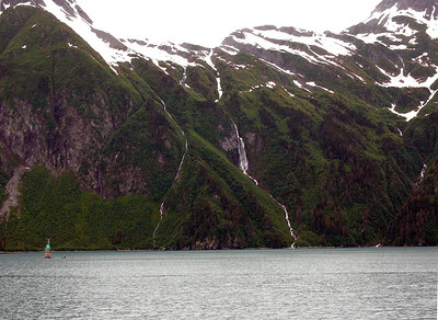 The Inside Passage is marked by deep fjords, tall snow-capped mountains, and lush green rain forests.  The numerous water falls are fed by the melting snow.