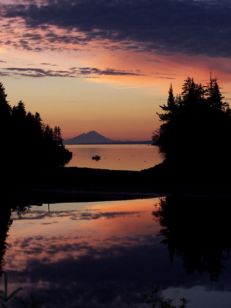 This sunset is from Little Tutka Lagoon out of Kachemak Bay between Seldovia and Homer, Alaska, with a view of the volcano Mt. Redoubt.
