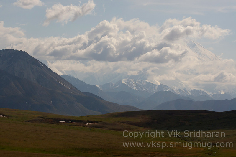 Denali (Mt. McKinley) shrouded by clouds.  The north face is visible on the right.